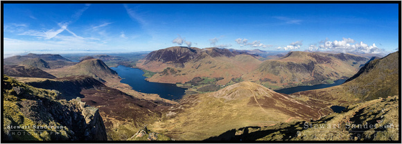 An iPhone panorama showing the most beautiful area of lakeland as viewed from the 2500ft summit of Red Pike. Loweswater, Melbreak, Crummock, Grasmoor, Robinson, Bleaberry Tarn, Buttermere, High Stile.